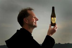 Fr Wulstan Peterburs OSB and a bottle of beer
